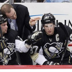 Pittsburgh Penguins coach Dan Bylsma, center, talks with Penguins' Steve Sullivan (26) and Sidney Crosby  (87) on the bench during the first period of an NHL hockey game against the Philadelphia Flyers in Pittsburgh, Sunday, April 1, 2012. The Flyers won 6-4.