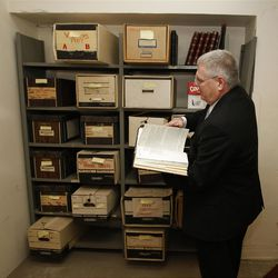 Neil Wilkinson looks through old records at the Joseph Smith Memorial Building for a special section on Hotel Utah's centennial Wednesday, May 18, 2011, above Salt Lake City, Utah.