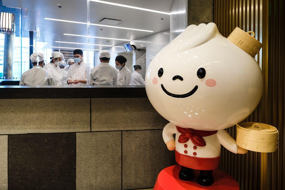A jaunty mascot with a soup dumpling as his head