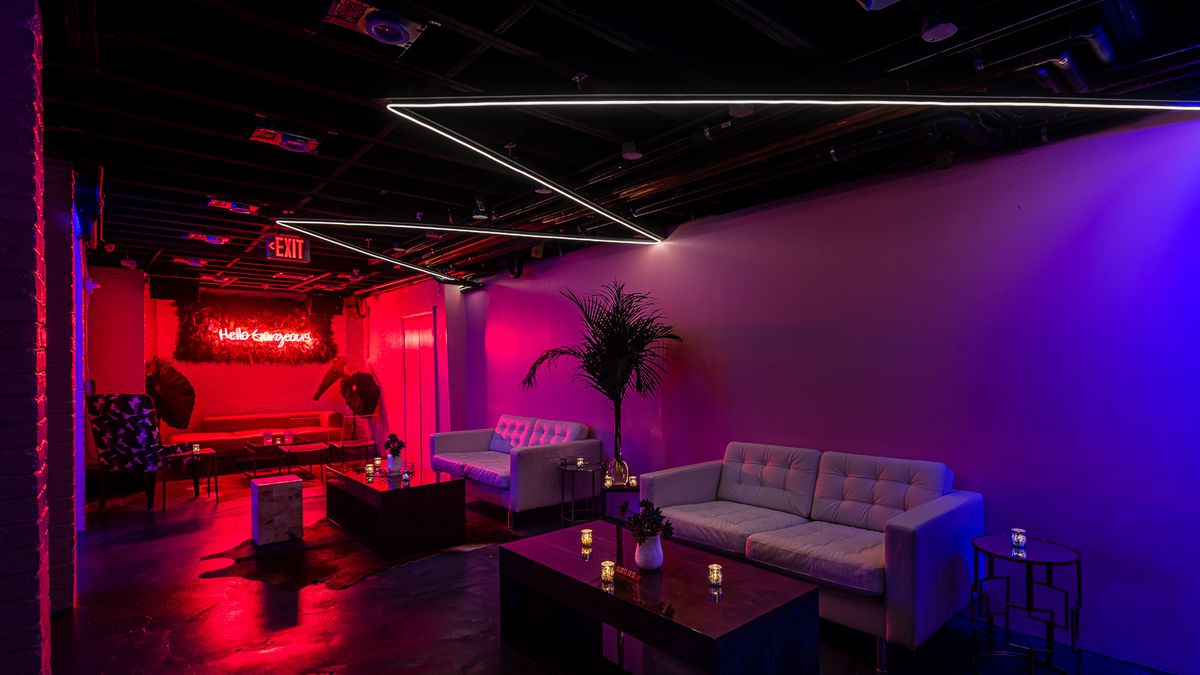 A pink-lit jungle room in the back of Never Looked Better can be sectioned off for events.