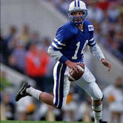 BYU quarterback Tom Young (14) is seen in one of the more traditional BYU uniforms.