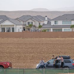 Spectators park along an adjacent road to see the groundbreaking service for the Red Cliffs Utah Temple of The Church of Jesus Christ of Latter-day Saints in St. George, Utah, Saturday, Nov. 7, 2020.