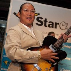 """<b>Masaharu Morimoto</b>: Who knows if Morimoto can actually play that thing, or if some PR person just handed it to him and said: """"Quick Morimoto! Rock and Roll!"""" He's really much better at <a href=""""http://eater.com/archives/2010/09/01/moonwalk"""