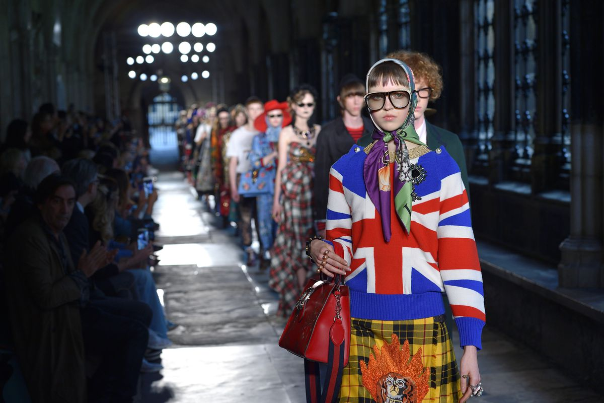 A model walks the runway at Gucci's resort show at Westminster Abbey wearing a Union Jack sweater.