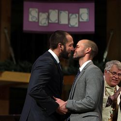 Matt Barraza and Tony Milner kiss during their wedding ceremony at the United Church of Christ in Holladay on Friday, Dec. 20, 2013. The Rev. Tom Norberg applauds. Barraza and Milner have been together for 11 years and have been raising their son Jesse since the day he was born four years ago.