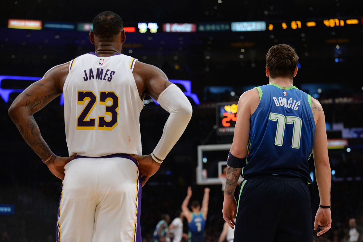 Los Angeles Lakers forward LeBron James and Dallas Mavericks forward Luka Doncic during a stoppage in play in the second half at Staples Center.