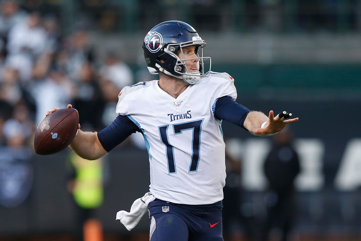 Quarterback Ryan Tannehill of the Tennessee Titans looks to pass the ball in the second half against the Oakland Raiders at RingCentral Coliseum on December 08, 2019 in Oakland, California.
