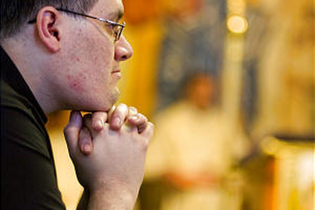 Seminarian Joseph Toledo prays during the morning Mass at the Redemptoris Mater House of Formation Roman Catholic seminary in Denver.