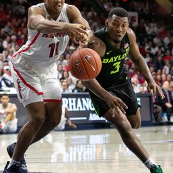 Arizona's Ira Lee (11) and Baylor's King McClure (3) scramble for a loose ball during the Arizona-Baylor game in McKale Center on December 15 in Tucson, Ariz.
