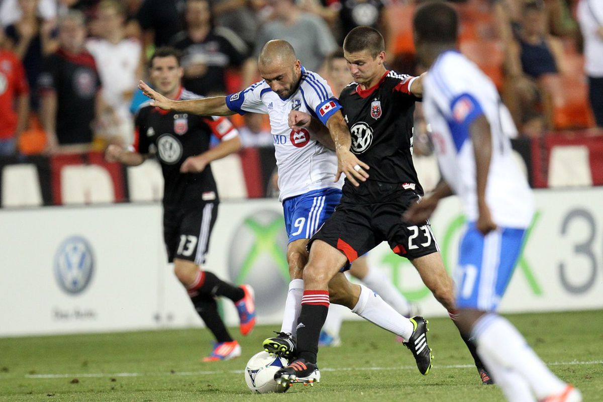 WASHINGTON, DC - JUNE 30: Marco Di Vaio #9 of the Montreal Impact controls the ball against Perry Kitchen #23 of D.C. United at RFK Stadium on June 30, 2012 in Washington, DC.(Photo by Ned Dishman/Getty Images)
