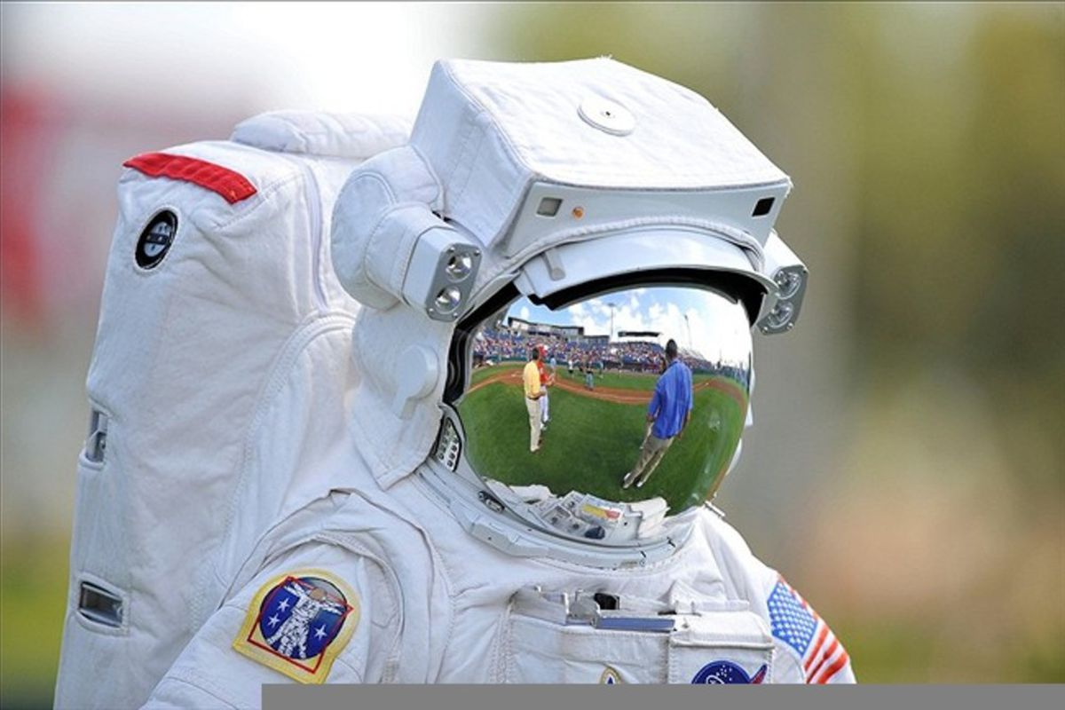 March 08, 2012; Melbourne, FL, USA; An astronaut walks out on the field before the spring training game between the Houston Astros and the Washington Nationals at Space Coast Stadium. Mandatory Credit: Brad Barr-US PRESSWIRE