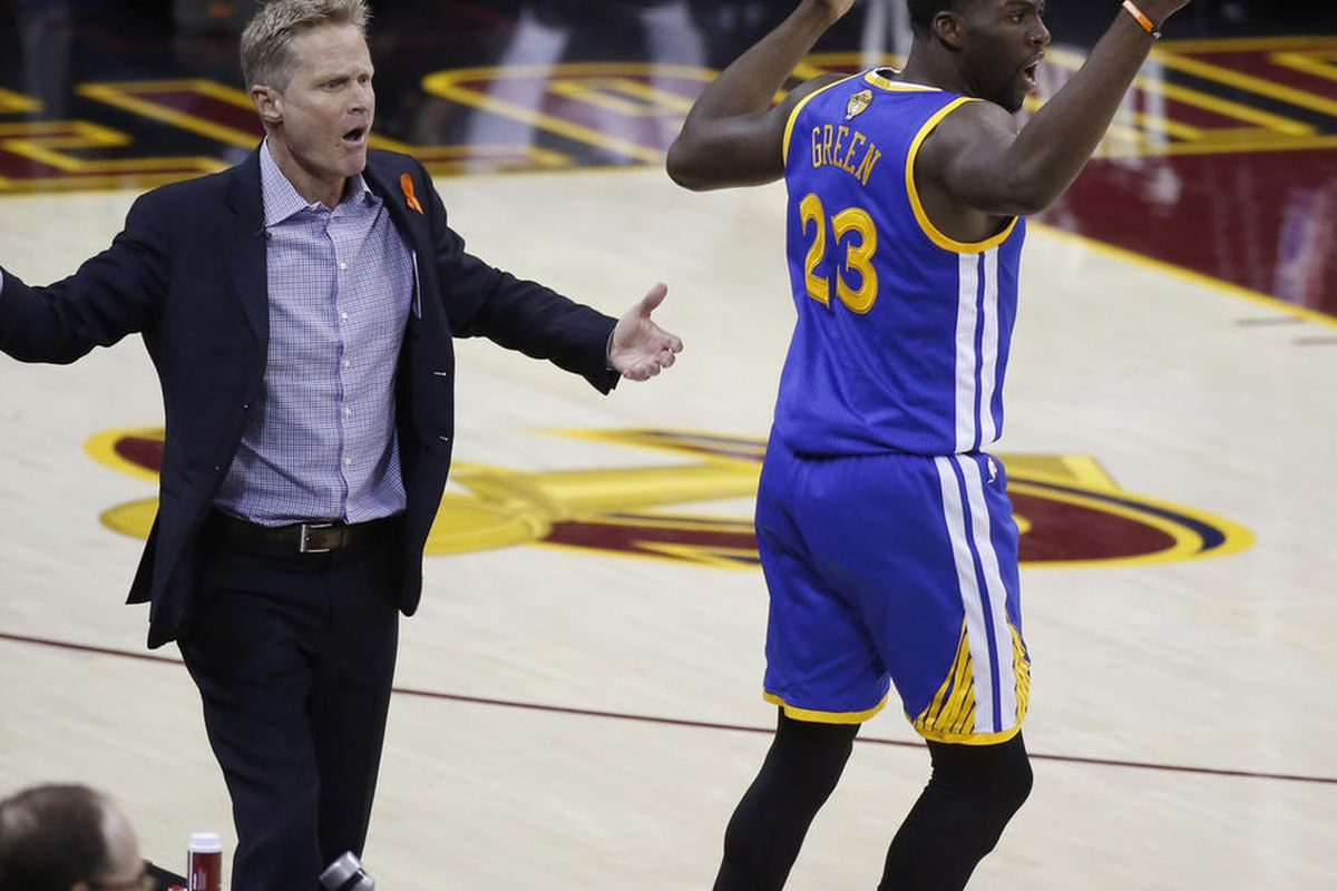 Golden State Warriors coach Steve Kerr and forward Draymond Green (23) react to a foul call during the first half of Game 4 in the basketball team's NBA Finals against the Cleveland Cavaliers in Cleveland, Friday, June 9, 2017. (AP Photo/Ron Schwane)