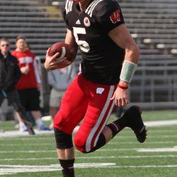 Quarterback Tanner McEvoy runs on a bootleg for a touchdown.