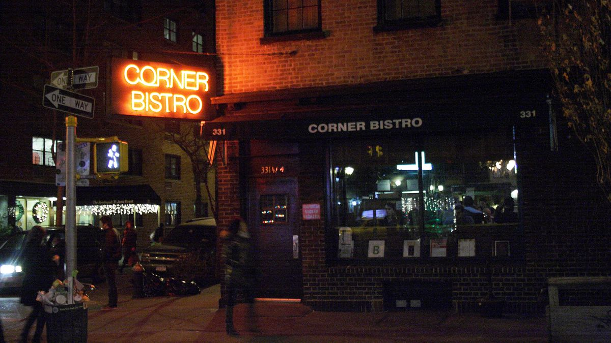 A neon sign harkens the entrance to Corner Bistro