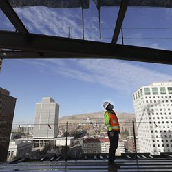 Sean Tuite, director of construction for City Creek Reserve, looks over the progress on 95 State at City Creek in Salt Lake City on Wednesday, Nov. 25, 2020. The 515,000-square-foot 25-story Class A office tower will feature cutting-edge technology incorporating state-of-the-art enhancements that allows touchless entry from the main door and throughout the property, thereby creating a safer and healthier workplace experience for tenants and visitors.
