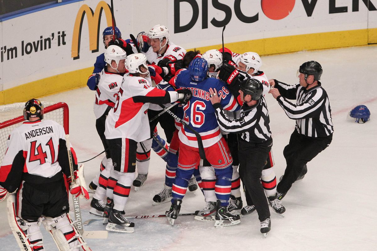 Apr 21 2012; New York, NY, USA;  Ottawa Senators and New York Rangers fight during the first period at Madison Square Garden.  Mandatory Credit: Anthony Gruppuso-US PRESSWIRE