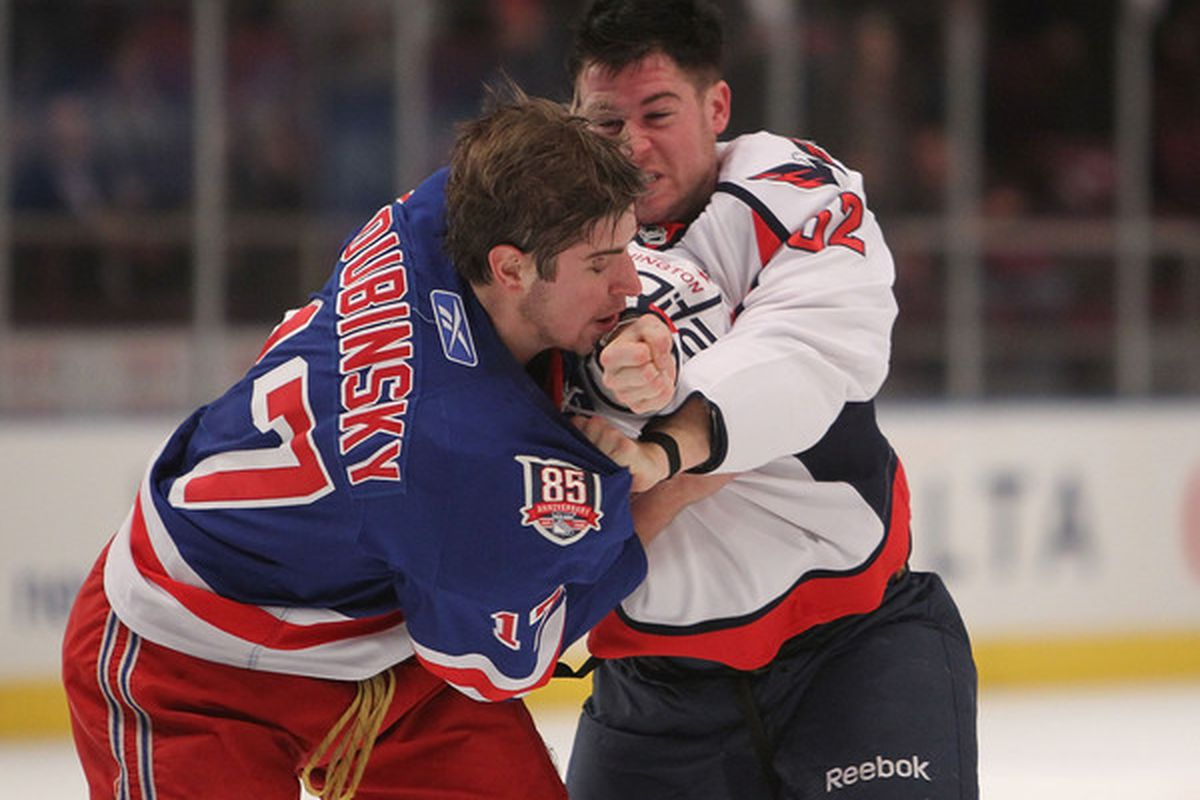 NEW YORK - NOVEMBER 09: Brandon Dubinsky #17 of the New York Rangers fights with Mike Green #52 of the Washington Capitals at Madison Square Garden on November 9 2010 in New York City.  (Photo by Nick Laham/Getty Images)