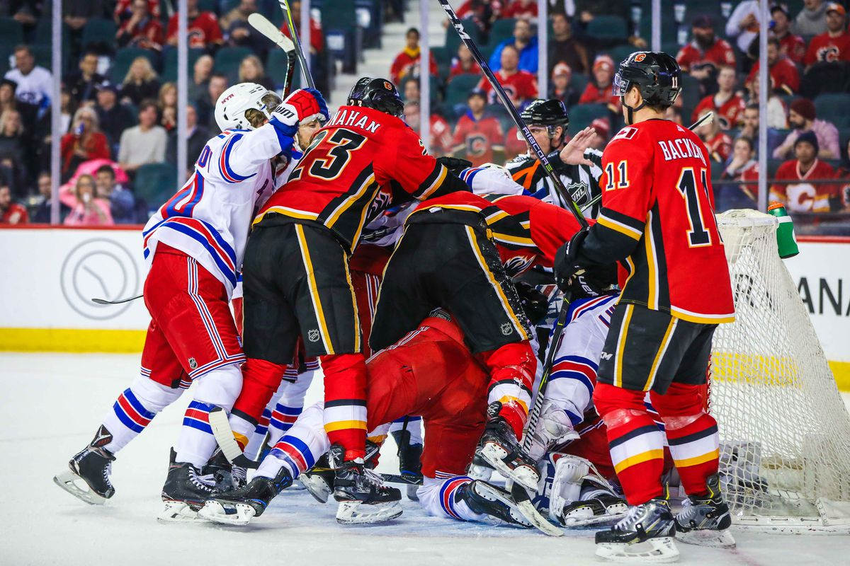 Mar 2, 2018; Calgary, Alberta, CAN; Calgary Flames players fight with New York Rangers players in front of New York Rangers goaltender Henrik Lundqvist (30) net during the third period at Scotiabank Saddledome. New York Rangers won 3-1.