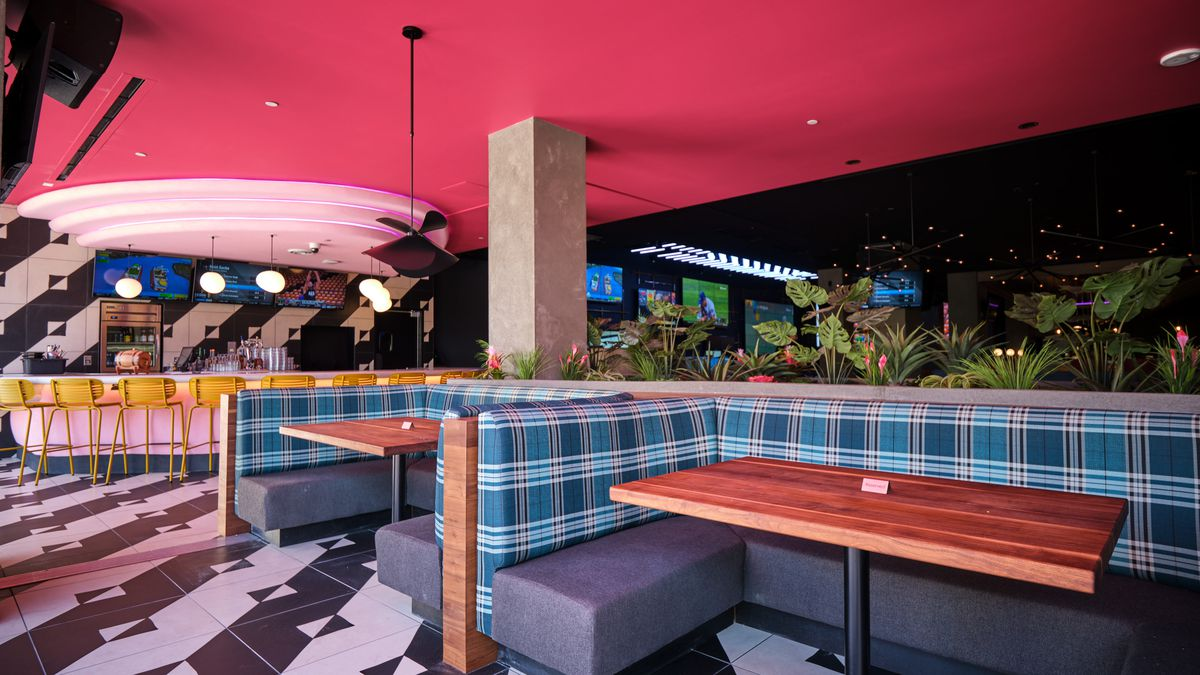A pink bar and blue plaid booths