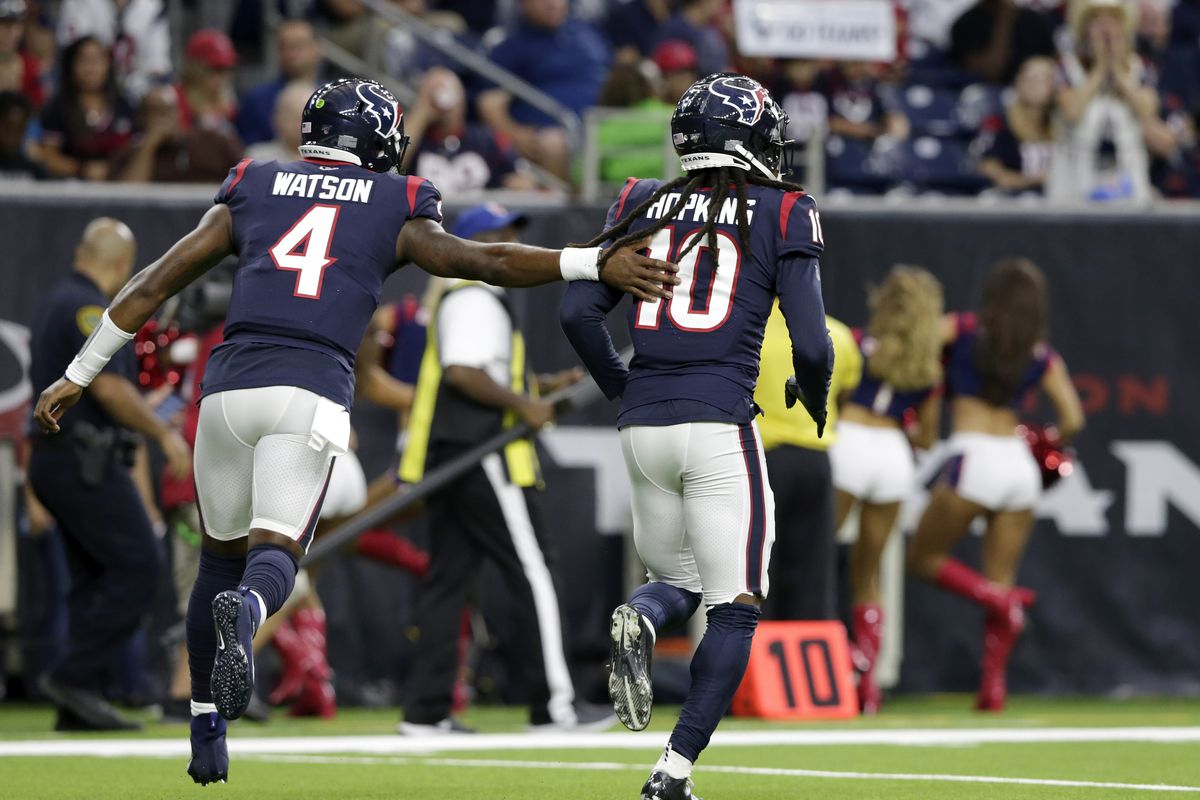 Deshaun Watson of the Houston Texans congratulates DeAndre Hopkins after a touchdown in the first quarter against the Detroit Lions during the preseason game at NRG Stadium on August 17, 2019 in Houston, Texas.