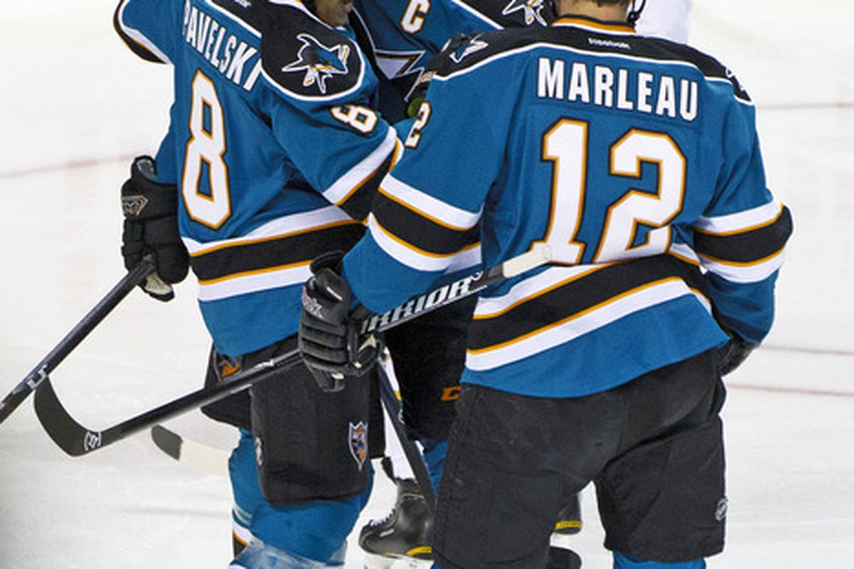 Mar 31, 2012; San Jose, CA, USA; San Jose Sharks center Joe Pavelski (8) is congratulated by teammates after scoring a goal against the Dallas Stars during the first period at HP Pavilion. Mandatory Credit: Jason O. Watson-US PRESSWIRE