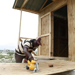 The LDS Church is building 200 homes near a resettlement camp outside Port Au Prince known as Canaan. Here, a local LDS Bishop supervises construction.