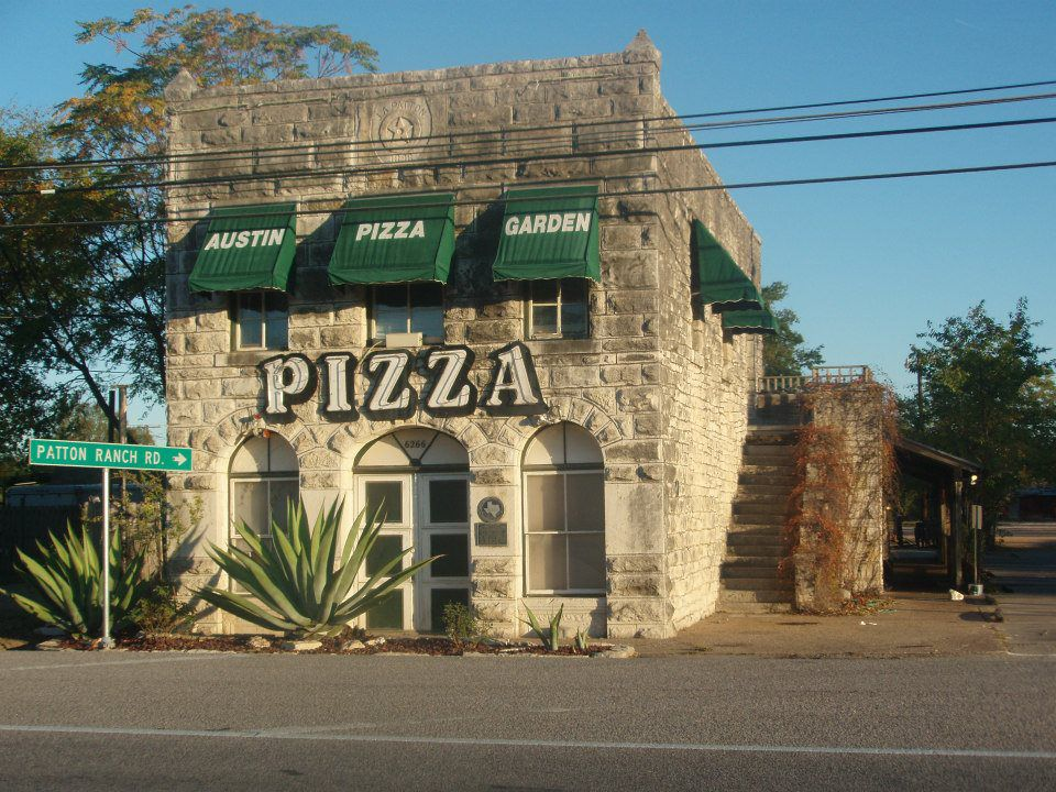 Historic stone building with green awnings
