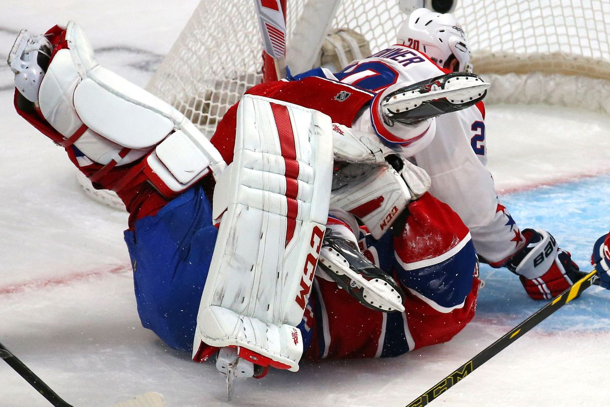 Jan 31, 2015; Montreal, Quebec, CAN; Washington Capitals right wing Troy Brouwer (20) falls on Montreal Canadiens goalie Carey Price (31) during the second period at Bell Centre.