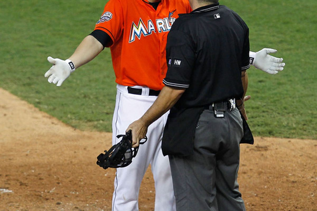 MIAMI, FL - MAY 12:  Logan Morrison #5 of the Miami Marlins argues with the umpire after striking out during a game against the New York Mets at Marlins Park on May 12, 2012 in Miami, Florida.  (Photo by Sarah Glenn/Getty Images)