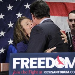 Former Pennsylvania Sen. Rick Santorum gets a hug from his wife Karen after announcing he is suspending his candidacy for the presidency, Tuesday, April 10, 2012, in Gettysburg, Pa.
