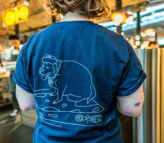 This dog and cheese t-shirt from The Cheesebar is some of the best restaurant merch to buy in London