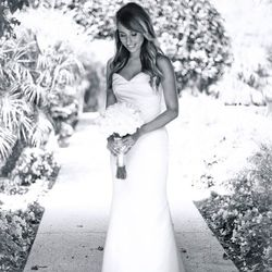 """""""For my big day I wanted a sleek and classic look. Thanks to the talented Soyon An and her team, the dress ended up being the perfect fit. I finished my look with a classic white veil, beaded vintage purse, and champagne Badgley Mischka peep toe heels."""" &"""