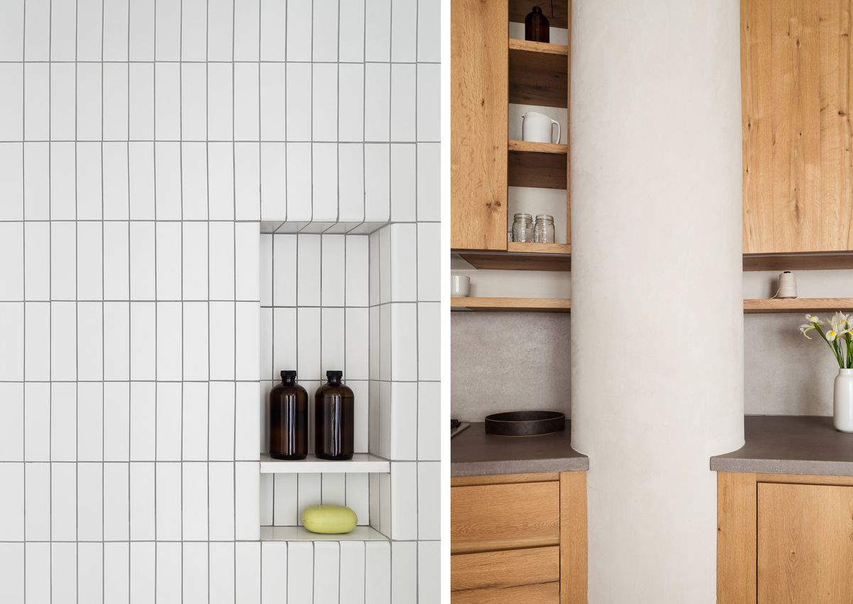 A bathroom has white tile installed vertically rather than horizontally. In the kitchen, concrete counters wrap around a big column.
