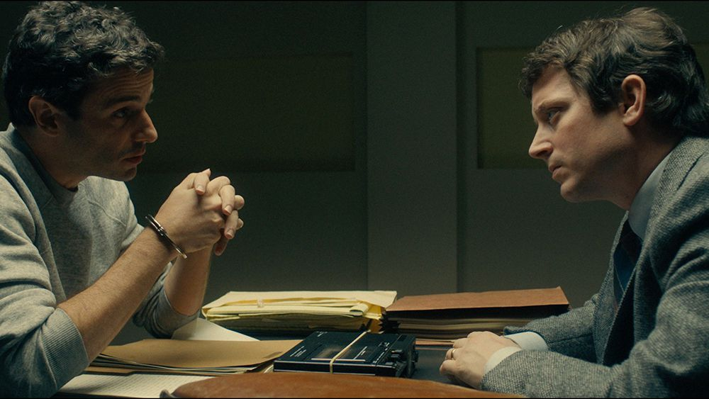 Ted Bundy (Luke Kirby) and Bill Hagmaier (Elijah Wood) sit across from one another in No Man of God
