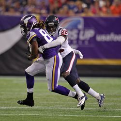 Aug 9, 2013; Minneapolis, MN, USA; Minnesota Vikings wide receiver Cordarrelle Patterson (84) is tackled by Houston Texans defensive back Roc Carmichael (22) during the first quarter at the Metrodome.