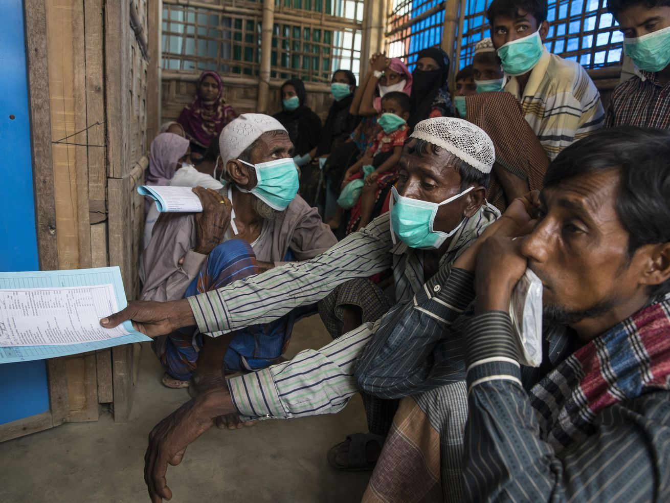 Patients wait for testing and medical treatment for tuberculosis at the Doctors Without Borders Kutupalong clinic on October 4, 2017, in Cox's Bazar, Bangladesh.
