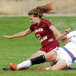 Timpanogos's #10 Breanna Brown, right, and Maple Mountain's #11 Sophie Card slide in the mud and water as they battle to control of the ball during play Tuesday, Sept. 25, 2012. Maple Mountain won 2-1.
