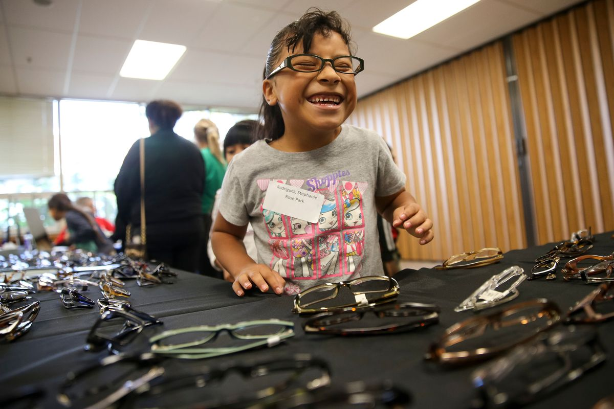 Stephanie Rodgriguez, 7, tries on glasses during the Friends for Sight SightFest at the Salt Lake Center for Science Education in Salt Lake City on Friday, Oct. 13, 2017.