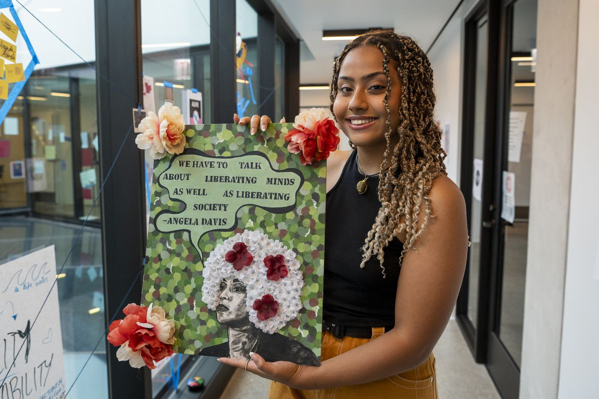 Alyha Khalil, 17, holds up her art piece that will be displayed at The Loft, located at Steppenwolf Theatre's Arts and Education Center on Halsted.