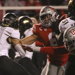 Utah Utes defensive end Bradlee Anae (6) and linebacker Devin Lloyd (20) reach around their blockers to stop Colorado Buffaloes running back Alex Fontenot (8) during the second half of an NCAA football game at Rice-Eccles Stadium in Salt Lake City on Saturday, Nov. 30, 2019.