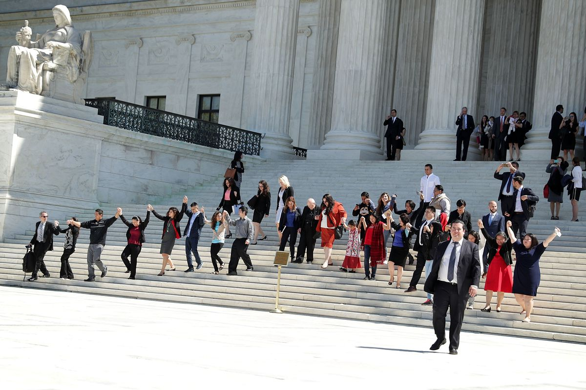 A group of demonstrators walks down the steps of the Supreme Court on Monday, when the court heard oral arguments in the immigration case United States v. Texas.