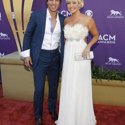 Joshua Scott Jones, left, and Meghan Linsey, of musical group Steel Magnolia, arrive at the 47th Annual Academy of Country Music Awards on Sunday, April 1, 2012 in Las Vegas.