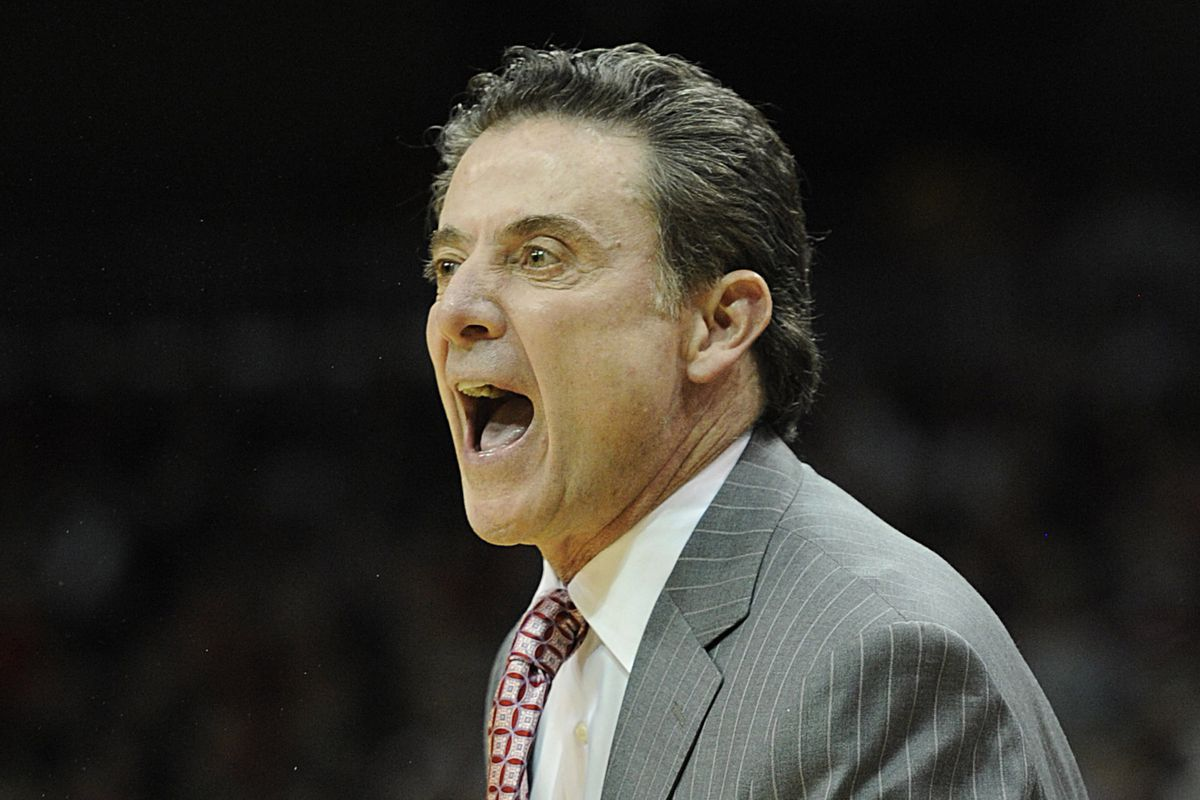 Rick Pitino shouts instructions to his charges (and possibly, officials), at the Yum! Center.