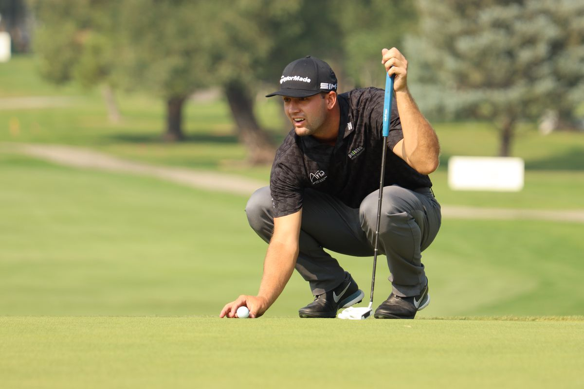 Taylor Montgomery sizes up a putt during the Korn Ferry Tour's Utah Championship.