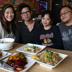 Ji with Isla Pilipina owners (left to right) founding owner Ray Espiritu and his business partners, siblings Sheila and Manny Manzanilla.| Brian Rich/Sun-Times
