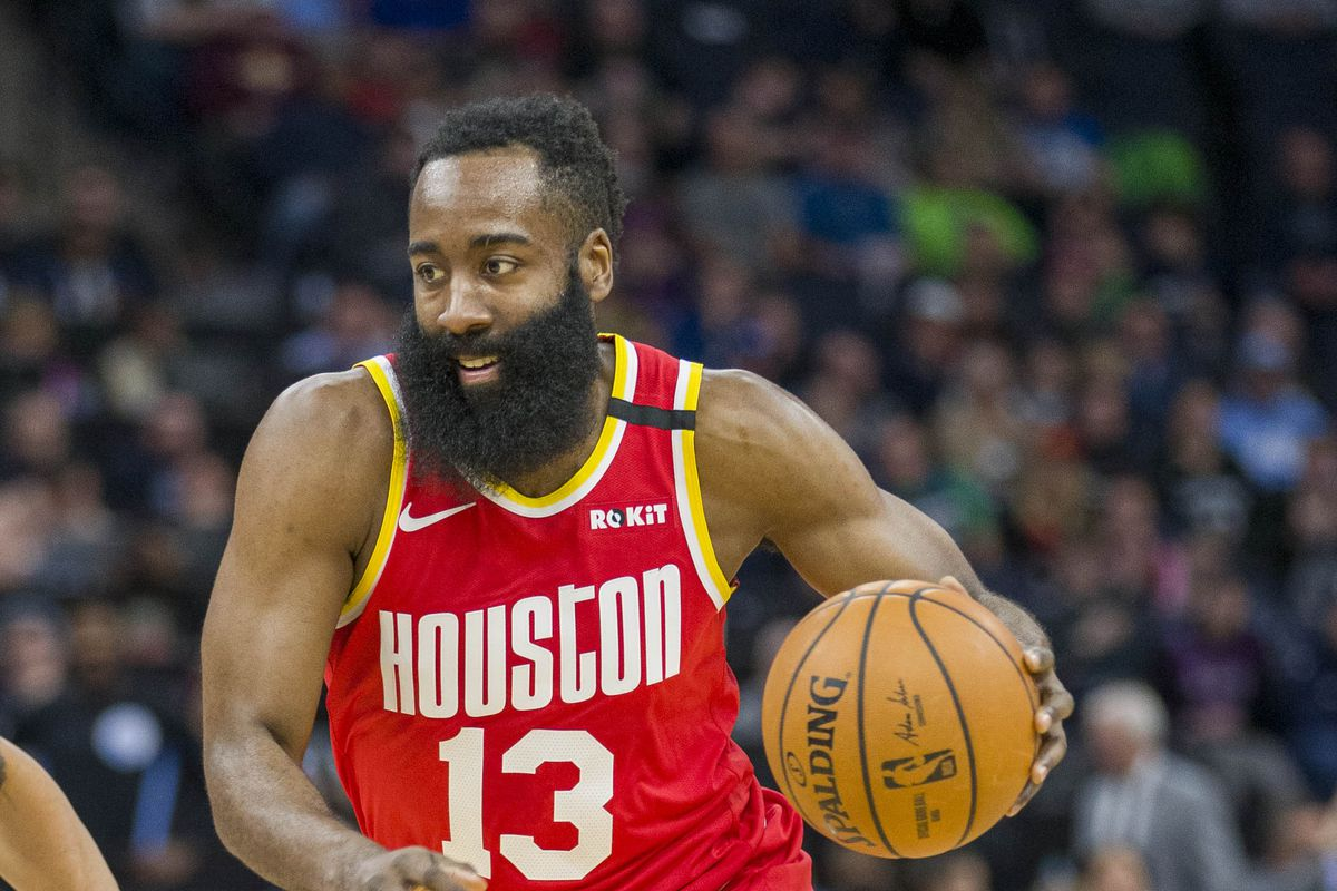 Houston Rockets guard James Harden dribbles the ball during the first half against the Minnesota Timberwolves at Target Center.