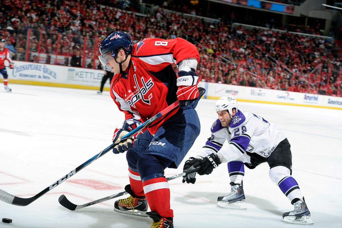 WASHINGTON DC - FEBRUARY 12:  Alex Ovechkin #8 of the Washington Capitals brings the puck down the ice against Jarret Stoll #28 of the Los Angeles Kings at the Verizon Center on February 12 2011 in Washington DC.  (Photo by Greg Fiume/Getty Images)