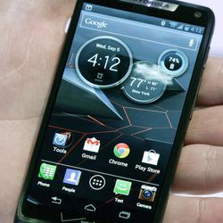 The new Droid Razr M is reviewed during a press conference on Wednesday, Sept. 5, 2012.  It's one of three new smartphones unveiled by Motorola since it became a part of Google.