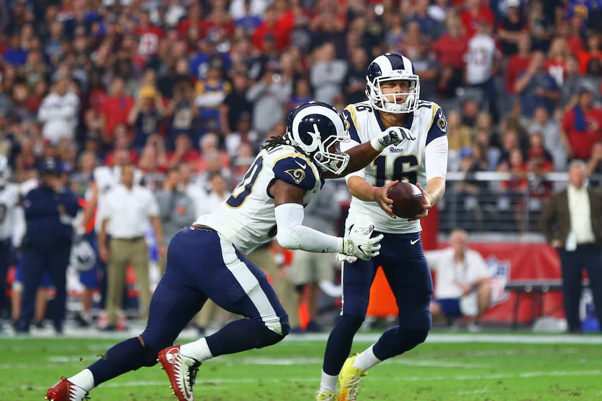 Los Angeles Rams QB Jared Goff hands the ball to RB Todd Gurley in Week 13 against the Arizona Cardinals, December 3, 2017.
