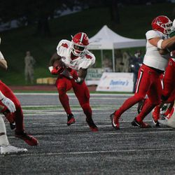 Malik Dunner running with the ball.  I'll have to say the Ball State running game looked pretty decent.<br>